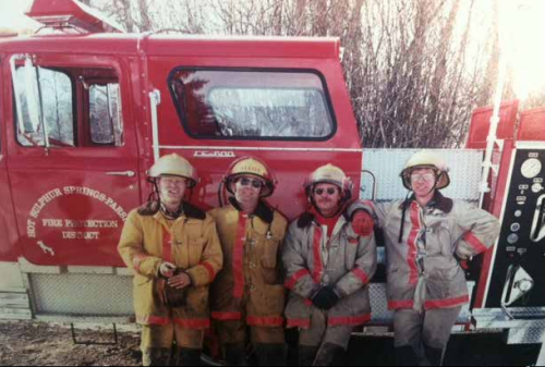Courtesy Photo: Firefighters Joe Vrbas, Bill Dixon, George Davis and Steve Gall stand next to Engine #286 in the late 1990s. Bill Dixon gives credit to Steve Gall for beginning to truly organize the volunteer fire department thirty years ago when Gall was chief.