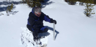 Mark Volt measures snow depth and water content at the Gore Pass snow course during the March 1st. snow survey. High elevation snowpack remains around 10% below normal in Middle Park. (Yep, he retired but still works part time measurin' snow)
