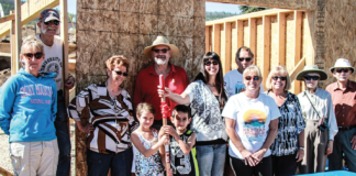 photo by Sally DiSciullo Habitat for humanity in Hot Sulphur! Left to right: Jodi Griesch of Habitat for Humanity, Dick Schamberger, Ann Schamberger, contractor George Davis, Homeowner Maria Archeletta-Jones, Judy Chlader, Chuck Chlader, Carol Schroer, Skip Schroer, and Shelly Heckerson