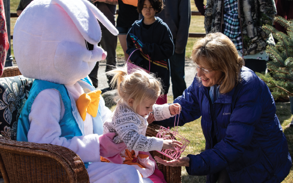 photo by Kim Cameron | Director Mary Jo Hargadine continues the tradition of including family at Cliffview events with granddaughter, Spero Hargadine.  The annual community Easter egg hunt is held at Cliffview.