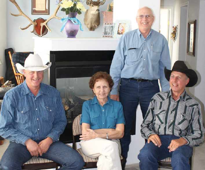 Geneva Sherman surrounded by her sons Rich, Marshall and Mike.